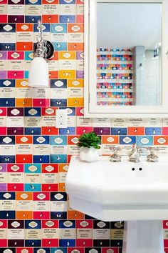 Bathroom With Penguin Library Wallpaper -- bright and whimsical wallpaper fits perfectly in this small bright bathroom for a serious dose of fun!