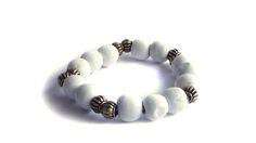 White and gold elastic bracelet. For price visit website Visit Website, Wooden Jewelry, Beaded Bracelets, Gold, Art, Art Background, Pearl Bracelets, Kunst, Performing Arts
