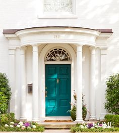 Beautiful peacock-colored front door from designer Andrea Brooks.