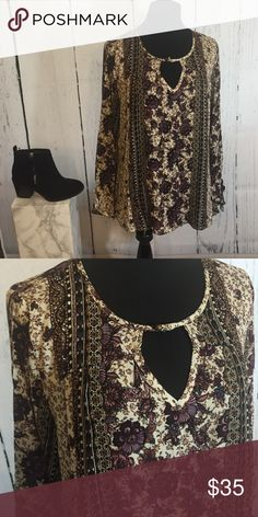 Flowing Flower Top Beautiful long sleeved flower top with maroon tones. This comfortable top is easy to pear with some jeans or leggings with booties! This top also comes with a replacement button for the keyhole chest. Tops