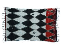 5ft x 3ft1in, AZ003 Azilal rug handknotted by Berber woman within the High Atlas Mountains of Morocco with 100% natural sheep wool. An abstract painting of white and black diamonds on a hand woven rug signifying protection against the evil eye.    Era: Vintage Condition: Excellent Materials: wool  Size: 5ft L x 3ft1in W  Color/Finish: Black-white-red.