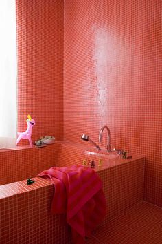 totally red tiled bathroom