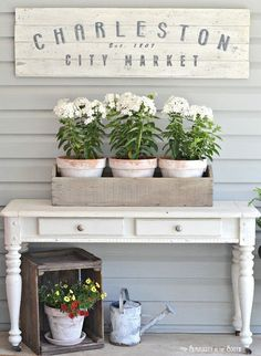 Are you looking for some simple ideas for decorating the front porch for the warmer weather months? Repurpose a tool caddy to hold potted plants and place it on a thrift store entry table. Come see more ideas and inspiration in this summer simplicity home tour. #spring #summer #decor