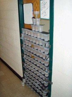dorm room door in university. Cups tower taped prank.