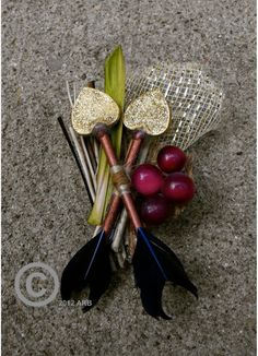 How cute is this THG boutonniere?It comes with a matching bouquet but I think you could also DIY something similar if you love the design. [Hunger Games Wedding Bouquet, Katniss, ORIGINAL Design, Summer, Fall, one of a kind, Organic, Boutonniere included. $95.00, via Etsy.]