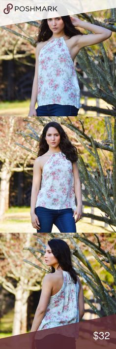 New Arrival Lovely Crush Top A high neck floral top featuring a back key hole & self tie.  Model is wearing a size small  98% Polyester / 2% Spandex Boutique Tops
