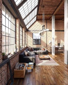 It would be great to have a loft apartment that looked like this! Love the brick, wood, and big windows!