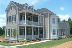 Beautiful Charleston style home in Verdae community.  Love the open porches and beautiful bay windows!