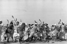 Refugees in India performing exercise to keep away depression by Henri Cartier-Bresson