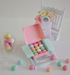 Sweet 1:12 scale macarons You will receive 12 miniature 1:12 macarons in pretty pastel colors. They come in a pink macaron box with light