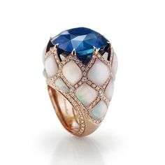 """Chantecler -Unique pieces of fine Jewellery- """"Fortress"""" Matelassé ring in pink Gold, cushion-cut blue Sapphire, Opal and Diamonds."""