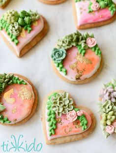 Elegant succulent garden cookies tutorial. The tiny edible cactus and flowers are made with royal icing, and they decorate sugar cookies painted in a watercolor style and flecked with real gold leaf.