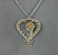 Handmade Sterling Silver and Gold Wire Wrapped by MystikCritterZ, $50.00