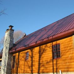 Best New Burgundy Standing Seam Metal Roof With Black Gutter 400 x 300