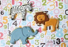 Lion and Zebra and Elephant Cookies Order Cookies, Iced Cookies, Sugar Cookies, Onesie Cookies, Elephant Cookies, Carnival Of The Animals, Icing Ingredients, Cookie Gifts, Reveal Parties