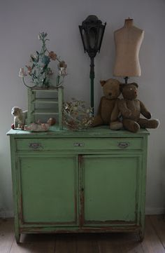 green cabinet with some good ole vintage stuff a top...