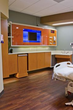 The mock-up patient room for Parkland also illustrates the hospital's concept for a large footwall screen that supports patient entertainment and education. It's equipped to later be used to view patient records and diagnostics, and provide two-way communication for telemedicine or patient visits. Credit: © HDR.