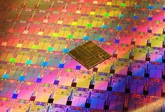 Processors on an Intel 45nm Hafnium-based High-k Metal Gate ''Penryn'' Wafer photographed with an original Intel Pentium processor die. Using an entirely new transistor formula, the new processors incorporate 410 million transistors for each dual core chip, and 820 million for each quad core chip. The original Intel Pentium Processor only has 3.1 million transistors.