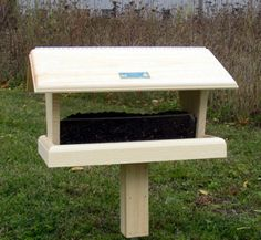Coveside Conservation A large feeder with a Plexiglas hopper for backyard birds of all sizes. Mounts easily and securely on a pole, post or deck. Hand crafted in Maine of sustainably grown Eastern Whi