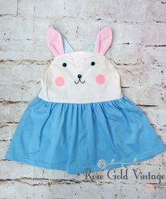 How sweet is this little Bunny dress? This has a woven bodice with knit skirt. Wear alone in warm months, or layer with a ruffled tee underneath or cardigan ove
