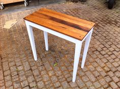 small table. top made by reclaimed oak wood, from 100 years old roof beam.