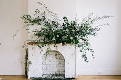Whitewashed walls and greenery en masse | Jess + Ryan's Baby Shower | HOORAY! Mag