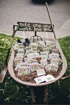 """""""TAKE ONE AND WATCH LOVE GROW"""" Seed Packet Wedding Favors in a Wheelbarrow"""