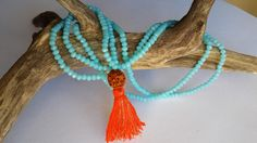 Turquoise Micro Swarovski Mala with Rudraksha guru bead and orange tassel.