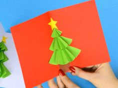 do love a card that pops and this Christmas card tree pop up card does just that. A simple Christmas craft for kids to make.We do love a card that pops and this Christmas card tree pop up card does just that. A simple Christmas craft for kids to make. Christmas Card Crafts, Holiday Crafts, Homemade Christmas, Christmas Trees, Christmas Paper, Pop Up Xmas Tree, Kids Christmas Art, Diy Christmas Cards Pop Up, Christmas Crafts For Kids To Make At School