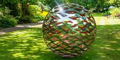 Spherical metal garden sculpture