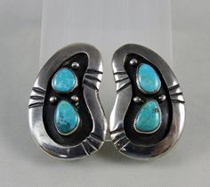 Bright blue natural turquoise is set in sterling silver shadow box style clip on earrings.