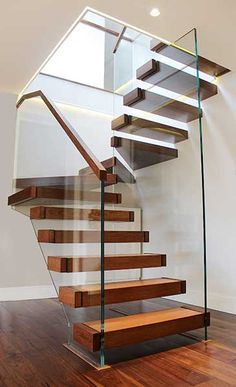 """Staircases: one of the first things your see when you enter a home. They have the potential for setting the impression of a home. Take a look at these statement staircases. If you want a builder who understands the """"wow factor"""" of a well built staircase, Hall Interior Design, Home Stairs Design, Interior Stairs, House Design, Interior Paint, Staircase Glass Design, Stair Design, Railing Design, Escalier Design"""