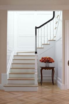High-gloss paint applied in the stairwell amplifies the sunshine pouring in from above. - Traditional Home ®/ Photo: Werner Straube / Design: Samantha Lyman