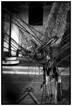 """""""Morning Star"""" by Paul Fryer.  Installation of Lucifer at the church of Holy Trinity Marylebone, Westminster, 2008  (Anodised aluminium, silicon rubber cord, wax work figure, feathers, aluminium, concrete) photo Tessa Angus"""
