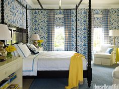 Designer Gideon Mendelson balanced the strong toile wallpaper and shade fabric with soft checked curtains in this bedroom.