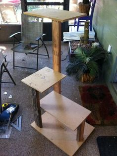 """I marked the uprights so I'd have some reference to fasten each level of the cat tower. Then, I assembled it in its entirety to check for fit prior to upholstery. What gets tricky is every piece gets ½"""" larger after upholstering. The carpet is about ¼"""" thick. I made up for that by cutting my boards a bit smaller (cut list is accurate), and trimming away some carpet in some locations on the uprights. You'll see where in the next few steps."""