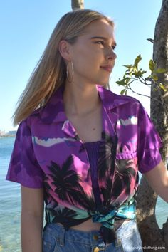 Pretty in Purple - Ladies Hawaiian Shirt Blouse 'Purple Palms'. Aloha shirt Casual or Fancy Dress. Wear this to a sports event or music festival.  #hawaiianshirt #ladieshawaiianshirt #ladiesshirt #purpleshirt #purpleparty #festivalfashion #cruisewear #luauparty