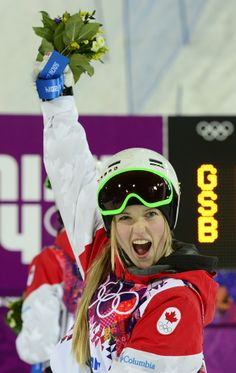 Gold Medallist, Canada's Justine Dufour-Lapointe celebrates during the Women's Freestyle Skiing Moguls Flower Ceremony at the Rosa Khutor Extreme Park during the Sochi Winter Olympics on February 8, 2014. AFP PHOTO / JAVIER SORIANO (Photo credit should read JAVIER SORIANO/AFP/Getty Images)