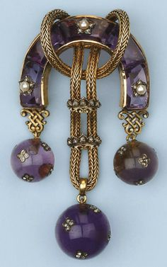 AN ANTIQUE AMETHYST, PEARL AND DIAMOND BROOCH. Designed as a horse-shoe shaped body set with calibrated amethysts, partly interspersed with pearl and diamond set stars, the centre with rope tied gold thread strung with two diamond set crown slides, supporting three amethyst spheres encrusted with rose-cut diamond set four-leaf clover appliqués, circa 1870.