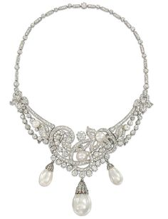 Natural Pearl and Diamond Necklace / Tiara of graduated design, the old-cut diamond scrolling motifs interspersed with similarly-set foliate panels and diamond single stone and natural pearl highlights, suspending three natural pearl drops with diamond-set cusp surmounts, to the diamond line back chain
