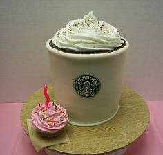 Starbucks Coffee  Starbucks Coffee This was 2 six inch and 1 eight inch round stacked and carved. wrapped in fondant and brown gel for coffee, icing on top