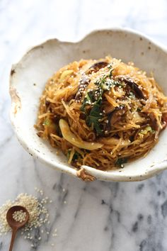 This vegetable chow mein recipe is made gluten-free by using spaghetti squash instead of noodles. It's also packed with bok choy and shitake mushrooms! #FallFest #glutenfree
