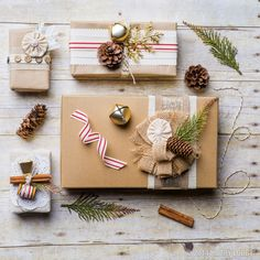 We love this mix of brown kraft paper, sweet peppermint ribbon, and natural accents.