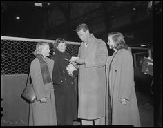 Ted Williams signs autographs at the sportsman's show  1954