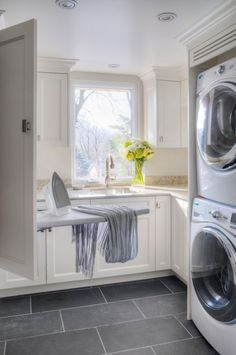 Stackables increase floor space in laundry room.  I would love to have this space with the natural lighting and the drop down ironing board