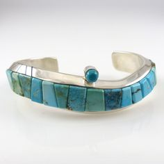 """Curved Sterling Silver Cuff Bracelet with an Offset Turquoise Stone and a Cobble Inlaid Design using Natural Turquoise from Blue Gem, Kingman, and Royston Turquoise Mines. .75"""" Cuff Width 4.875"""" Insid"""