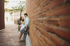 Engagement photo pose against a brick wall downtown | Kalamazoo, Michigan engagement and wedding photos — http://www.rhinomediaweddings.com/blog/2015/7/21/jason-allaina-kalamazoo-engagement-photos