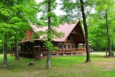Privacy on 17 acres, 15 minutes from Current River, schools, shopping. Local logs constructed this immaculate 2008 built home. 3 beds, 4 baths, over 3200 sq ft of beautiful log detailing throughout. Vaulted ceilings, masonry fireplace in living room with gas log. Upstairs master suite, wrap around deck, wood furnace or electric furnace. Your choice heats both levels of home. Public water, metal roof. Best looking home in Ripley County. Some marketable timber in Doniphan MO