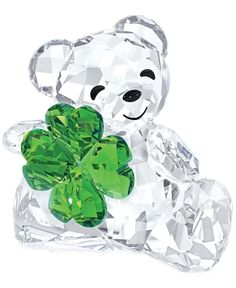 The legendary Swarovski Kris Bear becomes a lucky charm. Sparkling in clear crystal, this charming character is embellished with a four-leaf clover in green crystal, making sure that luck stays on you