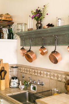 Meghan made this pot rack from wood found at a garage sale.